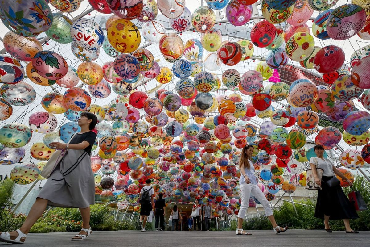 People walk under an array of Chinese lanterns celebrating the year of the pig outside a shopping mall in Bangkok, Thailand, 05 March 2019. Thailand's economy grew 4.1 percent in 2018, the highest growth since 2012, helped by domestic demand and tour