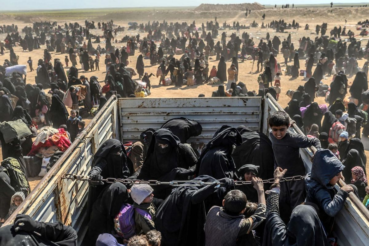 Women and children evacuated from the Islamic State group's embattled holdout of Baghouz arrive at a screening area held by the US-backed Kurdish-led Syrian Democratic Forces, in the eastern Syrian province of Deir Ezzor, on March 6, 2019. PHOTO: AFP