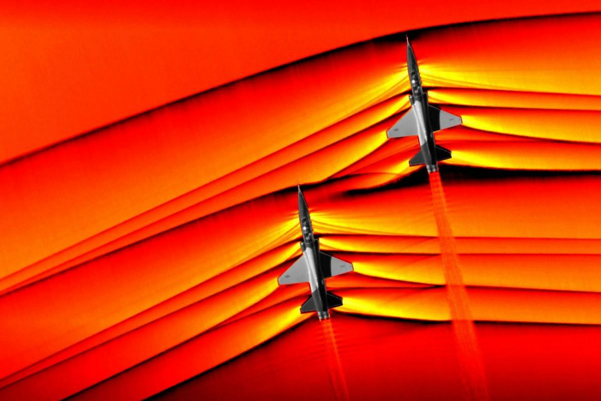 An undated handout photo made available by NASA photo shows two T-38 aircrafts in supersonic speed with shockwaves around them, at NASA's Armstrong Flight Research Center in Edwards, California, USA, Issued March 7, 2019. According to press release