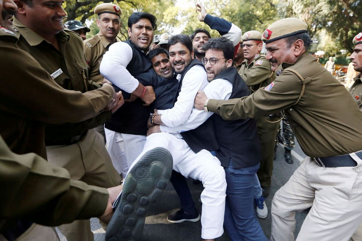 Police officers detain activists of the Delhi Pradesh Youth Congress during a protest demanding resignations of India's Prime Minister, Narendra Modi, and Defence Minister, Nirmala Sitharaman, over allegations of corruption in a Rafale fighter plan