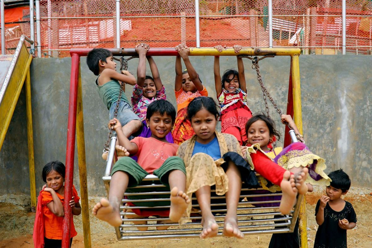 Rohingya refugee children play on a swing at a refugee camp in Cox's Bazar, Bangladesh, March 7, 2019. PHOTO: REUTERS