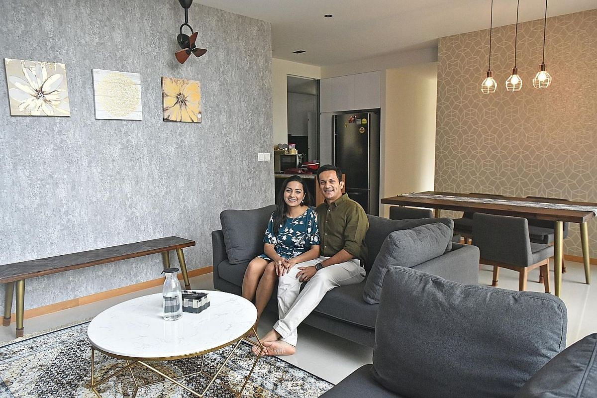 Mr Rohan Jain and his wife, Ms Soumya Bhagavatula, picked a light grey textured wallpaper for the living room wall and a soft gold one with metallic accent for the dining area.