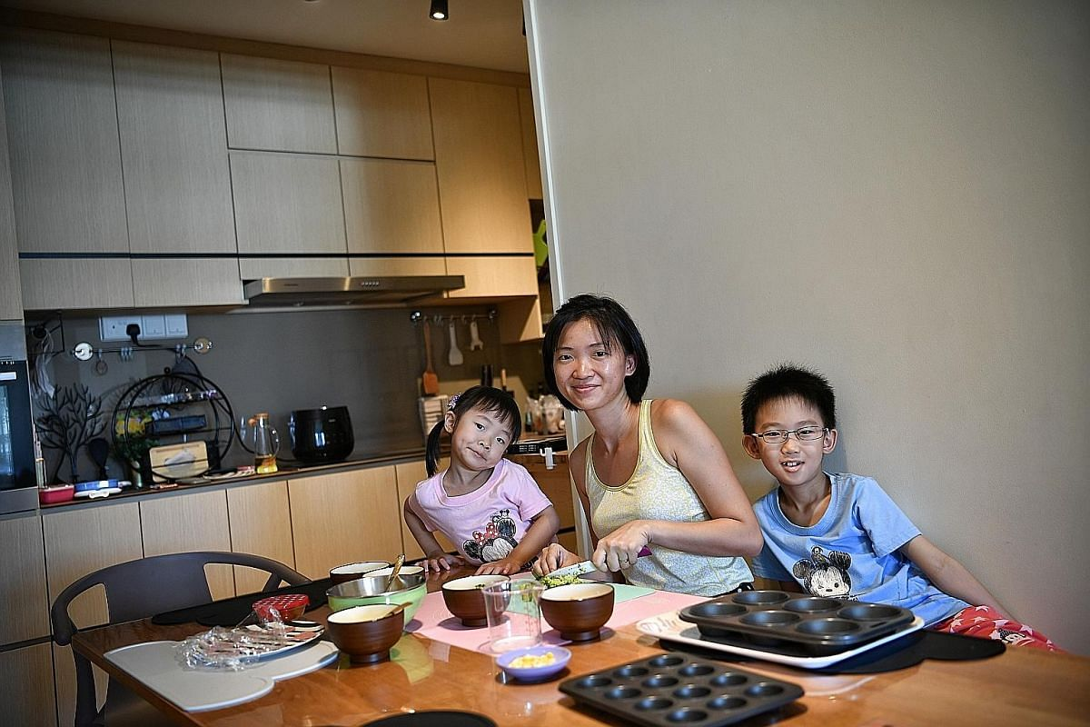 Ms Christine Koh bonding with daughter Yu Tong and son Cheng Jun as they prepare Baked Egg Muffins together.