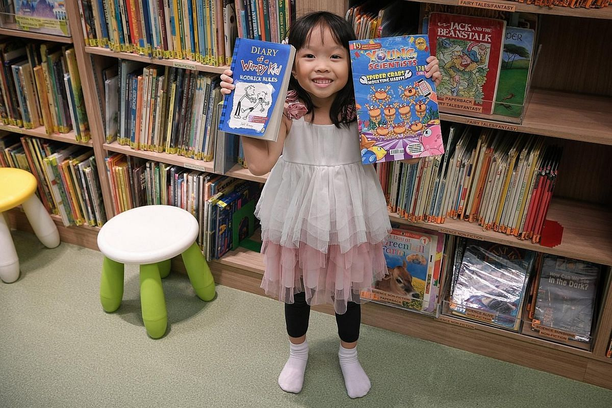 Stacie Khng (left), five, enjoys reading short articles in The Straits Times. Sashayna Vincent (left), six, could read WhatsApp messages when she was only 18 months old. Athena Wei (left), five, with two books for advanced readers of her age. She rea