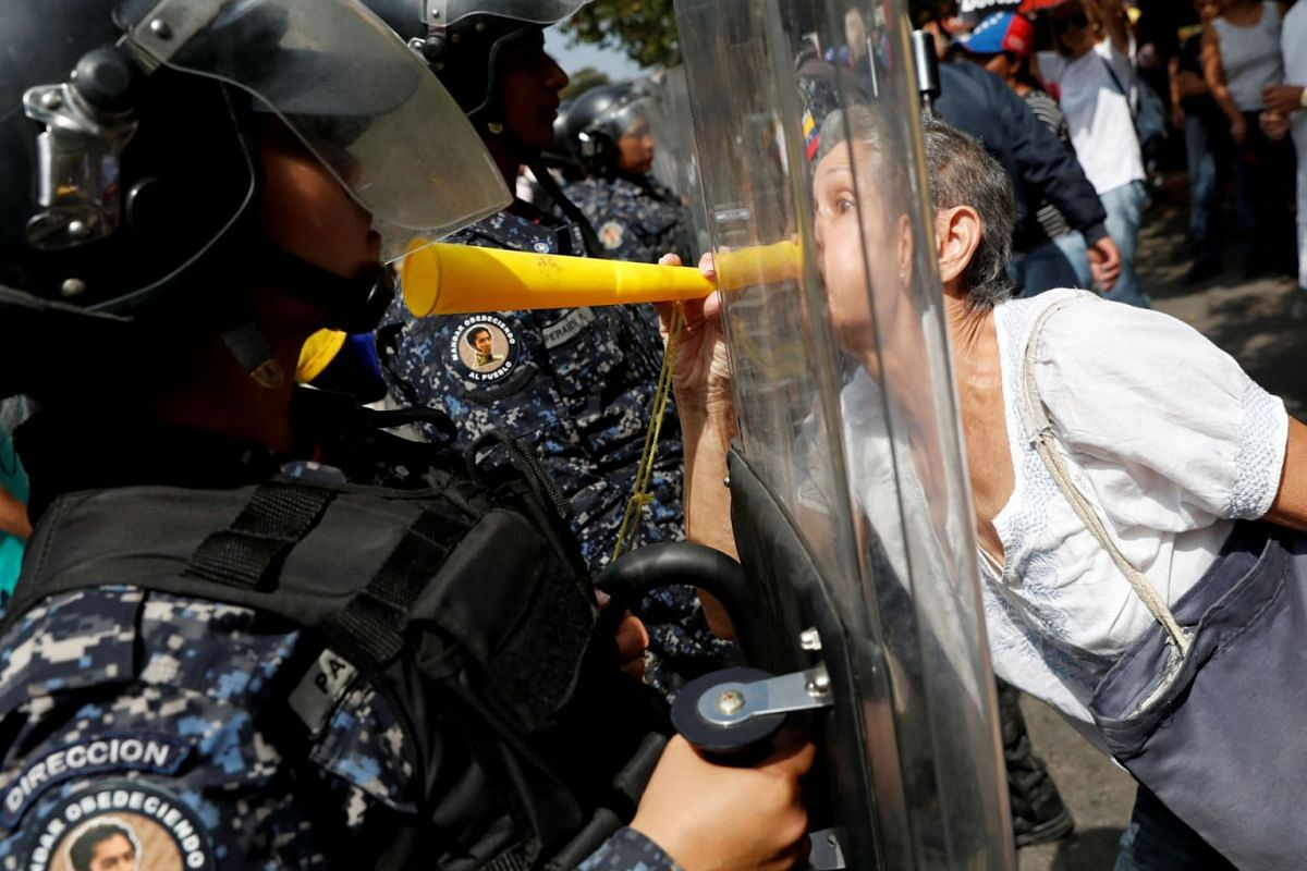 Opposition supporters clash with police in a rally against Venezuelan President Nicolas Maduro's government in Caracas, Venezuela, on March 9, 2019. PHOTO: REUTERS