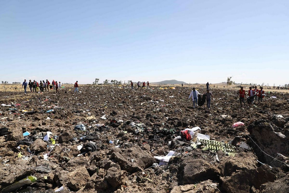 Rescue teams collect bodies in bags amid debris at the crash site of Ethiopia Airlines near Bishoftu, a town some 60km south-east of Addis Ababa, Ethiopia, on March 10, 2019. PHOTO: AFP