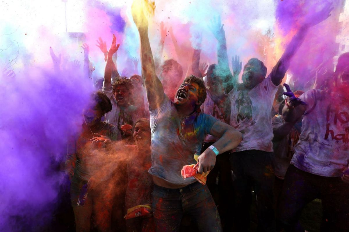 Participants throw coloured powder at one another during the Hindu Holi festival celebrations, also known as the Festival of Colours, at Dundee University on March 9, 2019, in Scotland, Dundee. PHOTO: PA WIRE VIA DPA