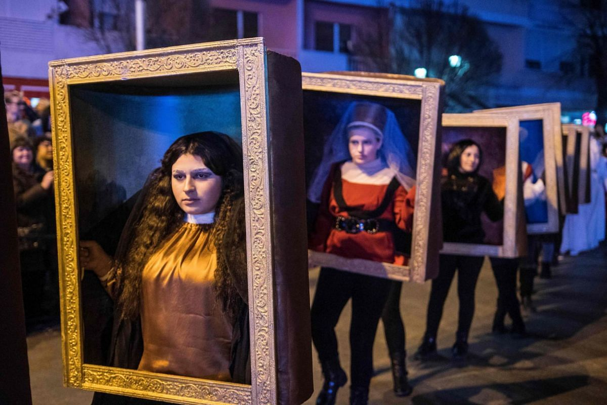 Costumed revelers parade the streets of Strumica, Macedonia, on carnival night on March 9, 2019. PHOTO: AFP