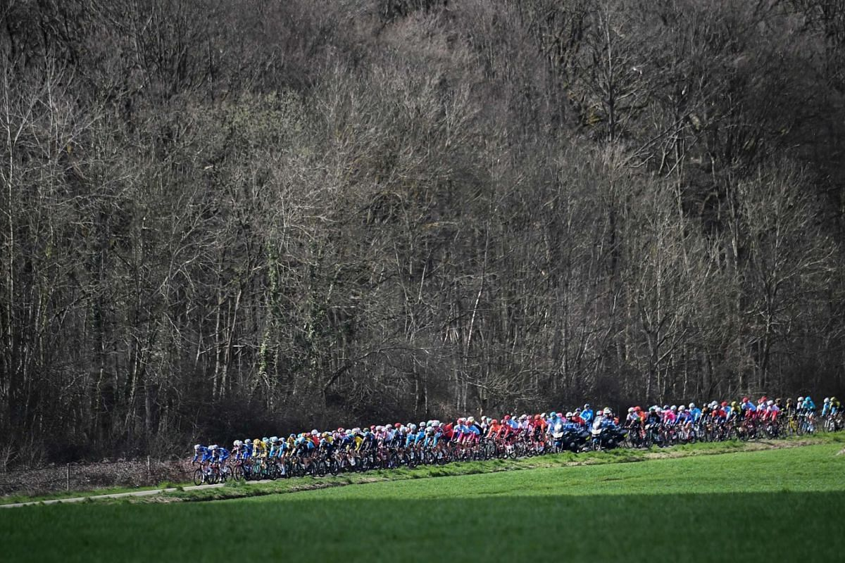 The pack rides during the 165.5km 2nd stage of the 77th Paris-Nice cycling race between Les Breviaires and Bellegarde, on March 11, 2019. PHOTO: AFP