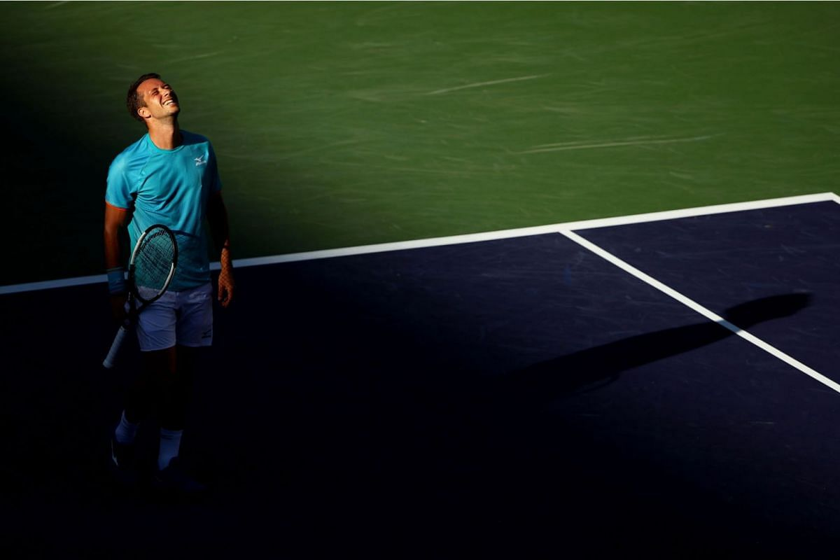 Philipp Kohlschreiber of Germany celebrates after his straight sets victory against Novak Djokovic of Serbia during their men's singles third round match on day nine of the BNP Paribas Open at the Indian Wells Tennis Garden on March 12, 2019 in India