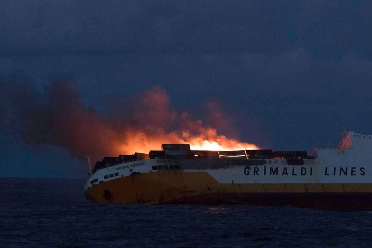 This handout picture released on March 12, 2019 and taken on March 11 by the French Marine Nationale shows flames on the Italian merchant ship Grande America off the coasts of the French Brittany. The crew of the Royal Navy grigate HMS Argyll has sav