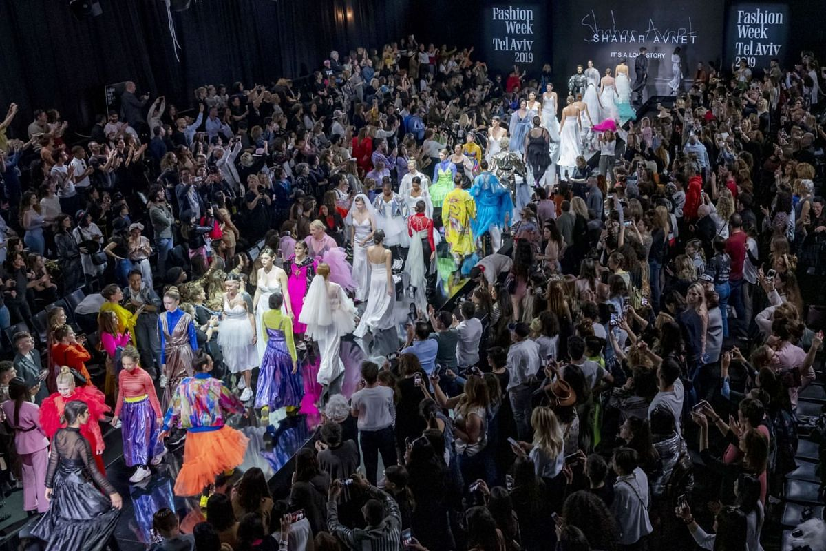 Israeli models and dancers on the runway at the close of the show by Israeli designer Shahar Avnet in her show called 'A Love Story', in several acts, during the Tel Aviv Fashion Week in Tel Aviv, Israel, March 13, 2019. PHOTO: EPA-EFE
