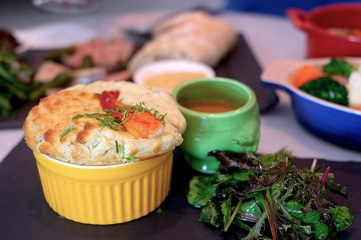 The bits of lobster meat and a small shelled claw in the lobster souffle make it a decent offering.