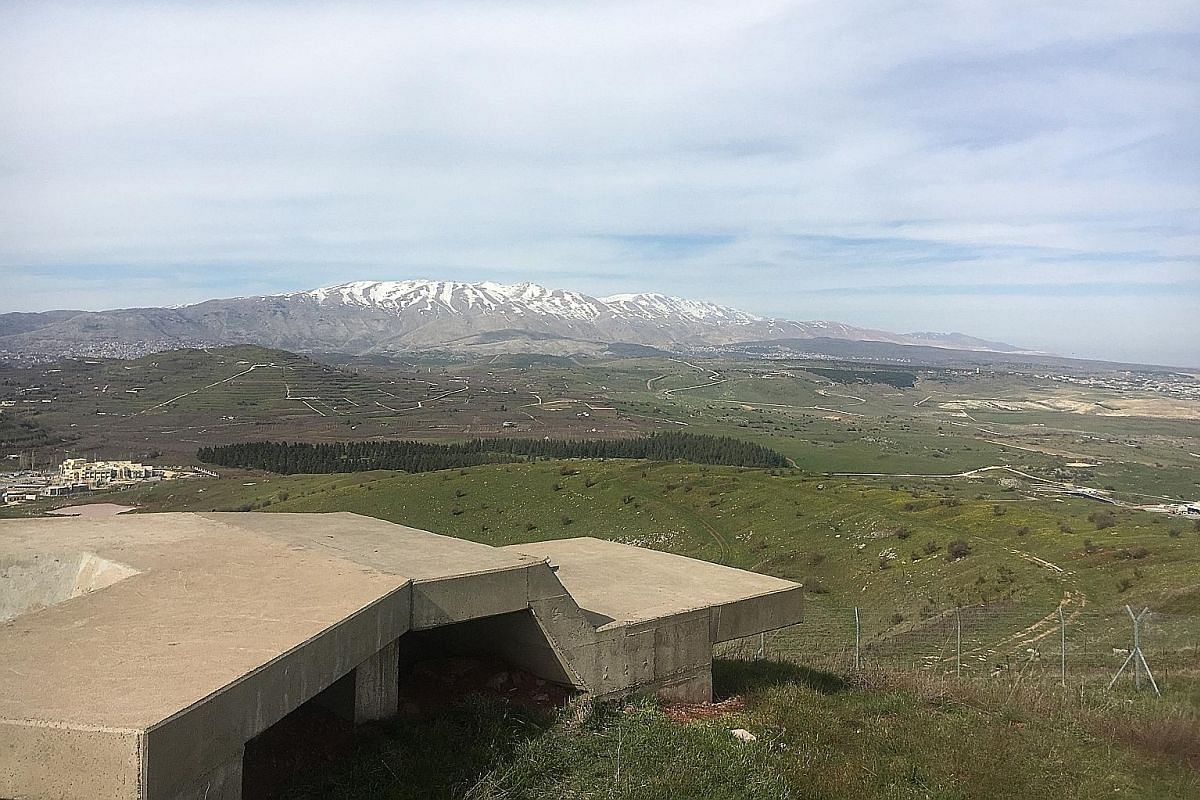"""A view from an Israeli army position on Mount Hermon and the Syrian border in the Golan Heights. Israeli security sources told ST the Hizbollah militia decided last year to form a special unit called the """"Golan File"""" with the goal of recruiting Syria"""