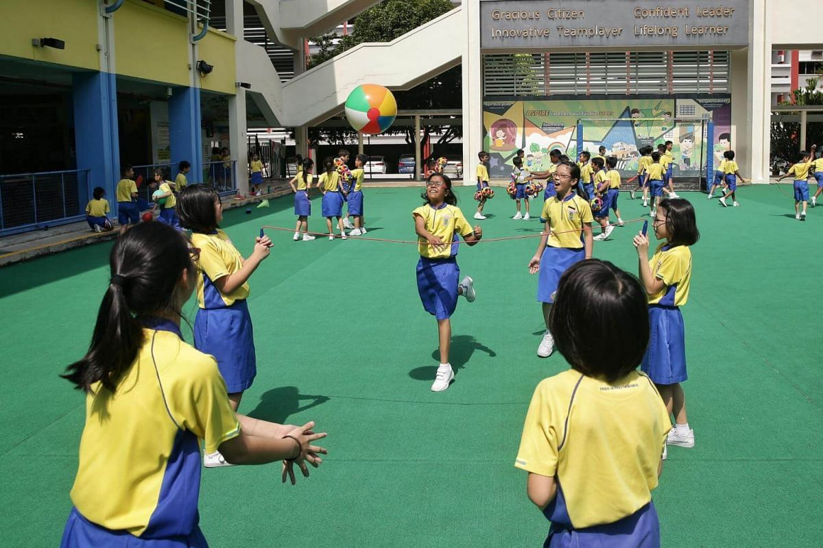 Pupils indulging in their own version of volleyball during unstructured play at Punggol Primary School, on Mar 14, 2019.