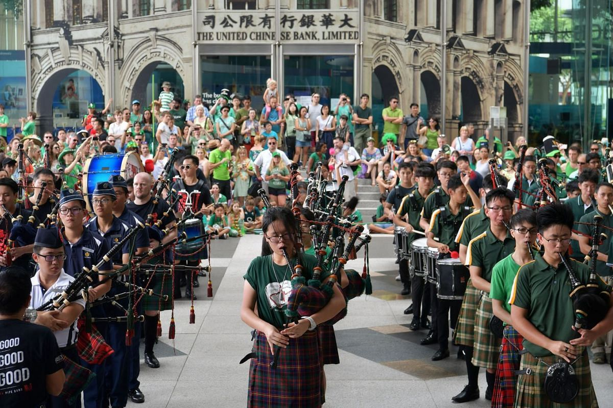Members of Pipe organ bands from schools in Singapore, including St. Joseph Institution and Raffles Girls' School perform at the St. Patrick's Day parade at UOB Plaza. About 400 people from the Irish community in Singapore turn up for its annual