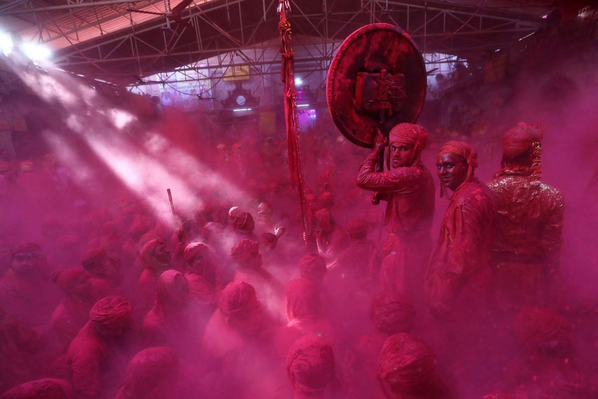 Hindu men from the villages of Nandgaon and Barsana celebrate covered with colored powder the Lathmar Holi festival at the Radha Rani temple in Barsana village, Mathura, India, 15 March 2019. Holi is the Hindu spring festival of colors. In Barsana, p