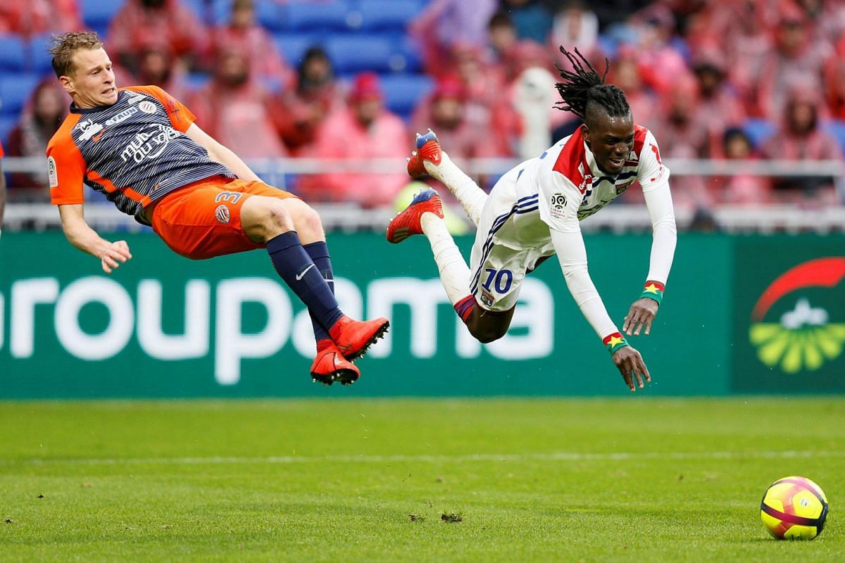 Montpellier's Nicolas Cozza in action with Lyon's Bertrand Traore during Olympique Lyonnais's match with Montpellier at Groupama Stadium, in Lyon, France on March 17, 2019 in the French football Ligue 1.  PHOTO: REUTERS