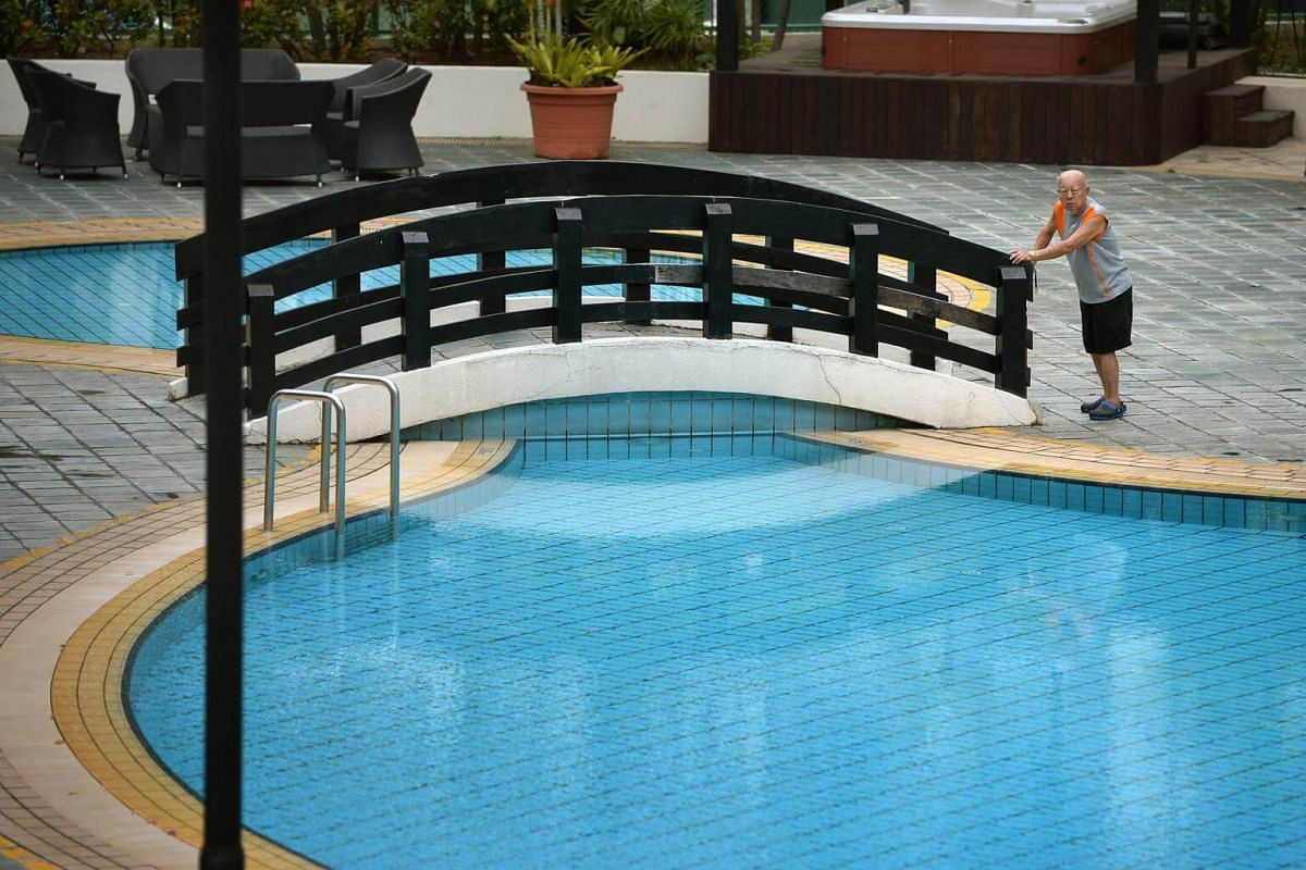 An elderly man attempting to cross the bridge over a swimming pool at the Chiltern Park Condominium located along Serangoon Ave 3, on Aug 24, 2014.