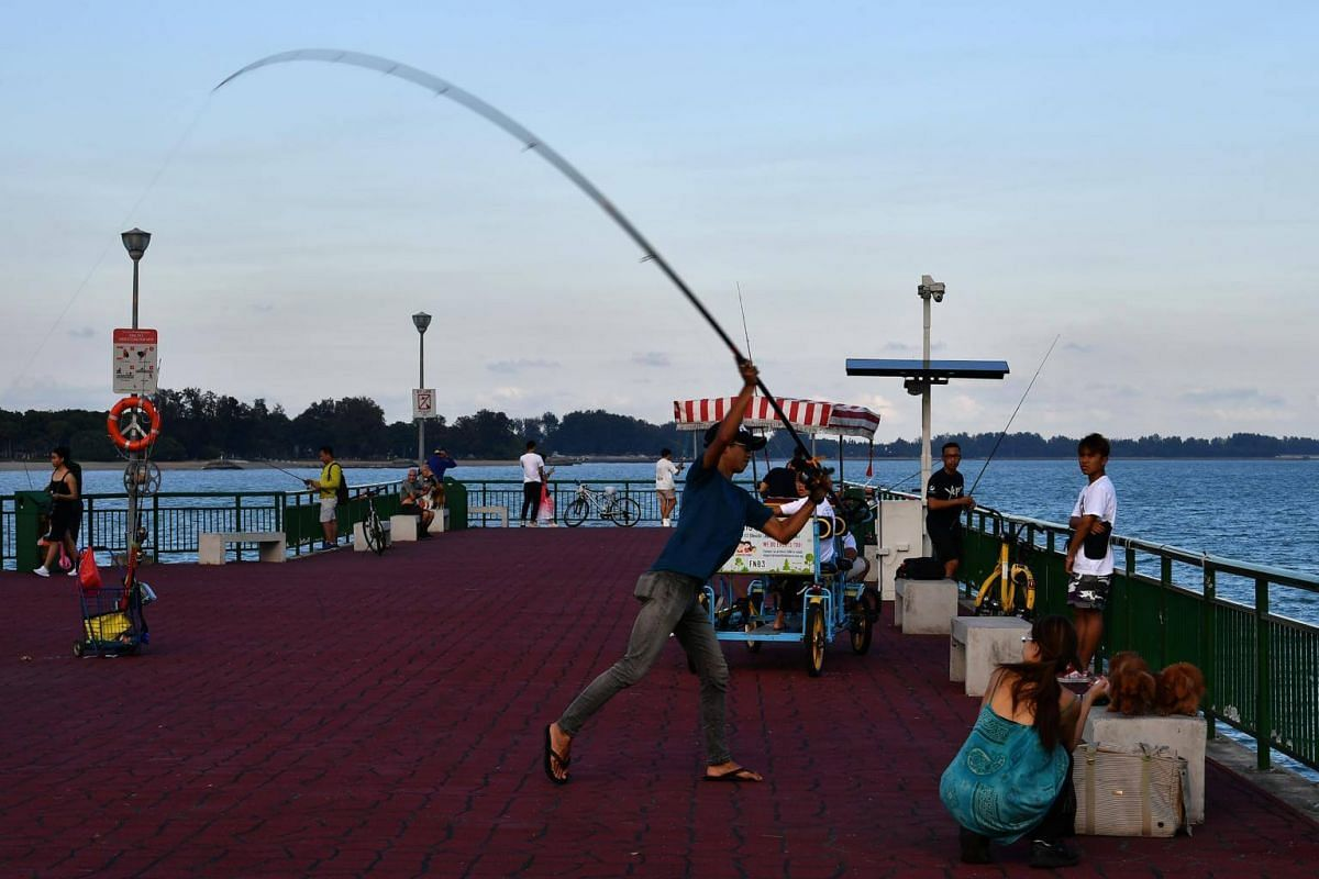 People fishing and relaxing at Bedok Jetty, on Feb 19, 2019.