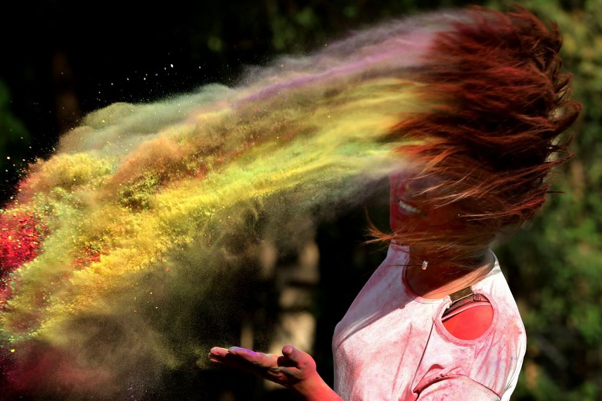A college girl takes part in the Holi festival celebrations in Bhopal, India, 19 March 2019. Holi is celebrated on the full moon day and marks the beginning of the spring season. Holi will be celebrated as the Hindu spring festival of colors across t
