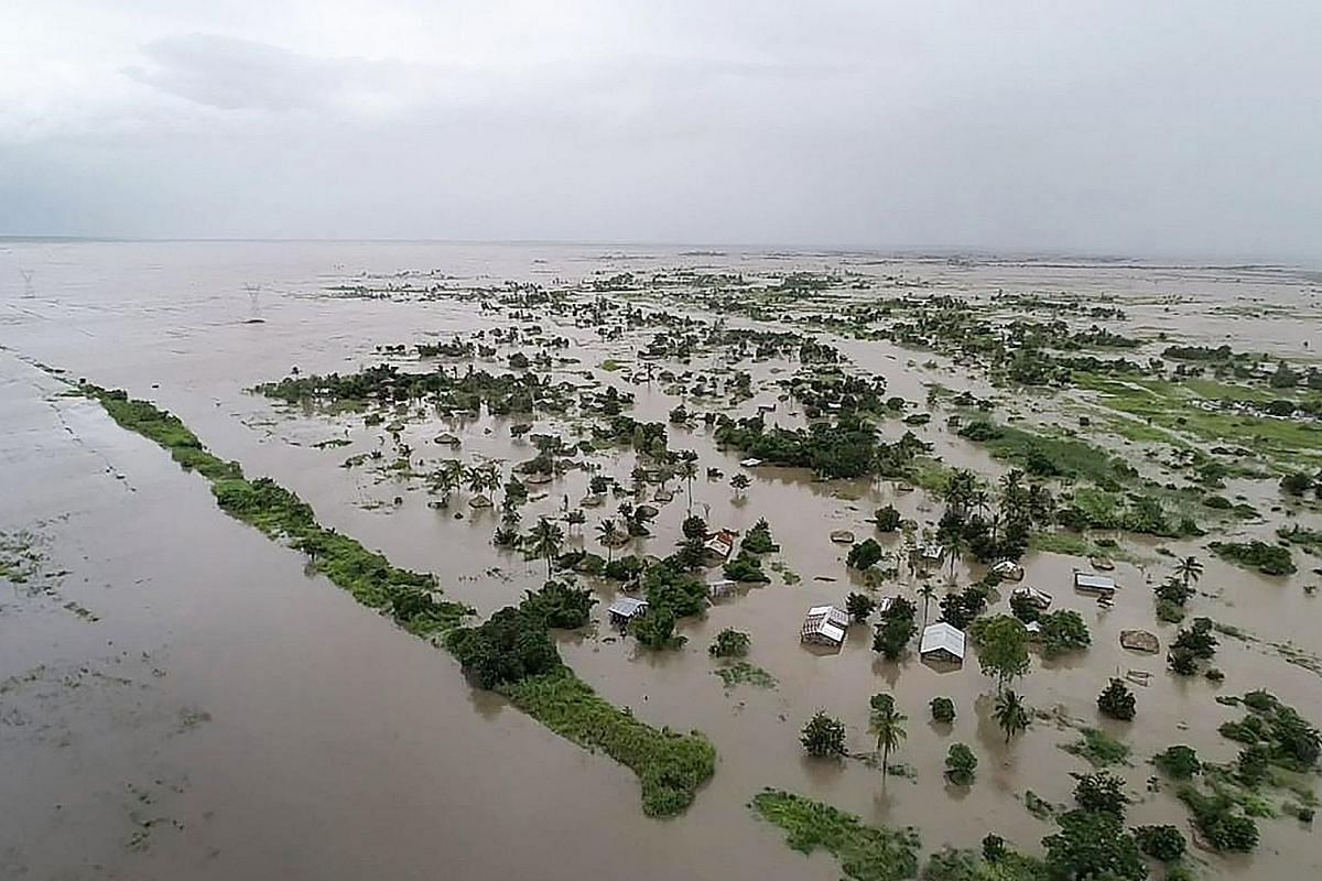 An aerial view of flooded houses after the tropical Cyclone Idai made landfall near the heavily populated Mozambican port city of Beira on Monday, from a photo released by the United Nations World Food Programme. Mozambique's President Filipe Nyusi s