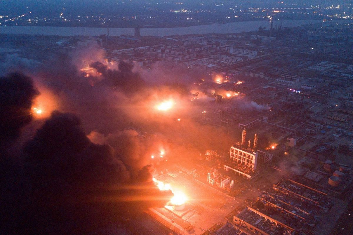 Smoke billows from fire following an explosion at the pesticide plant owned by Tianjiayi Chemical, in Xiangshui county, Yancheng, Jiangsu province, China March 21, 2019. A huge explosion rocked a chemical plant in eastern China, killing at least six