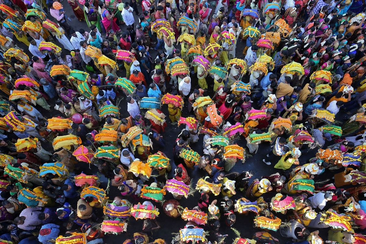 Devotees take part in a procession during the religious festival of Panguni Uthiram celebrated in honour of the Hindu god Muruga in Ahmedabad, India, March 21, 2019. PHOTO: REUTERS
