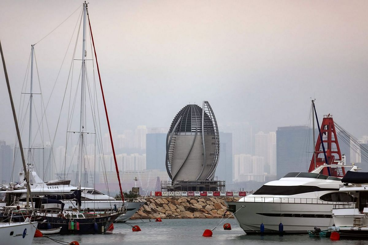 The leaf-shaped ventilation shaft (C) for the air purification system of the Central-Wan Chai bypass tunnel is seen beyond anchored boats in Hong Kong on Mar 17, 2019. Hong Kong this year opened a 3.7km tunnel equipped with an air purification system