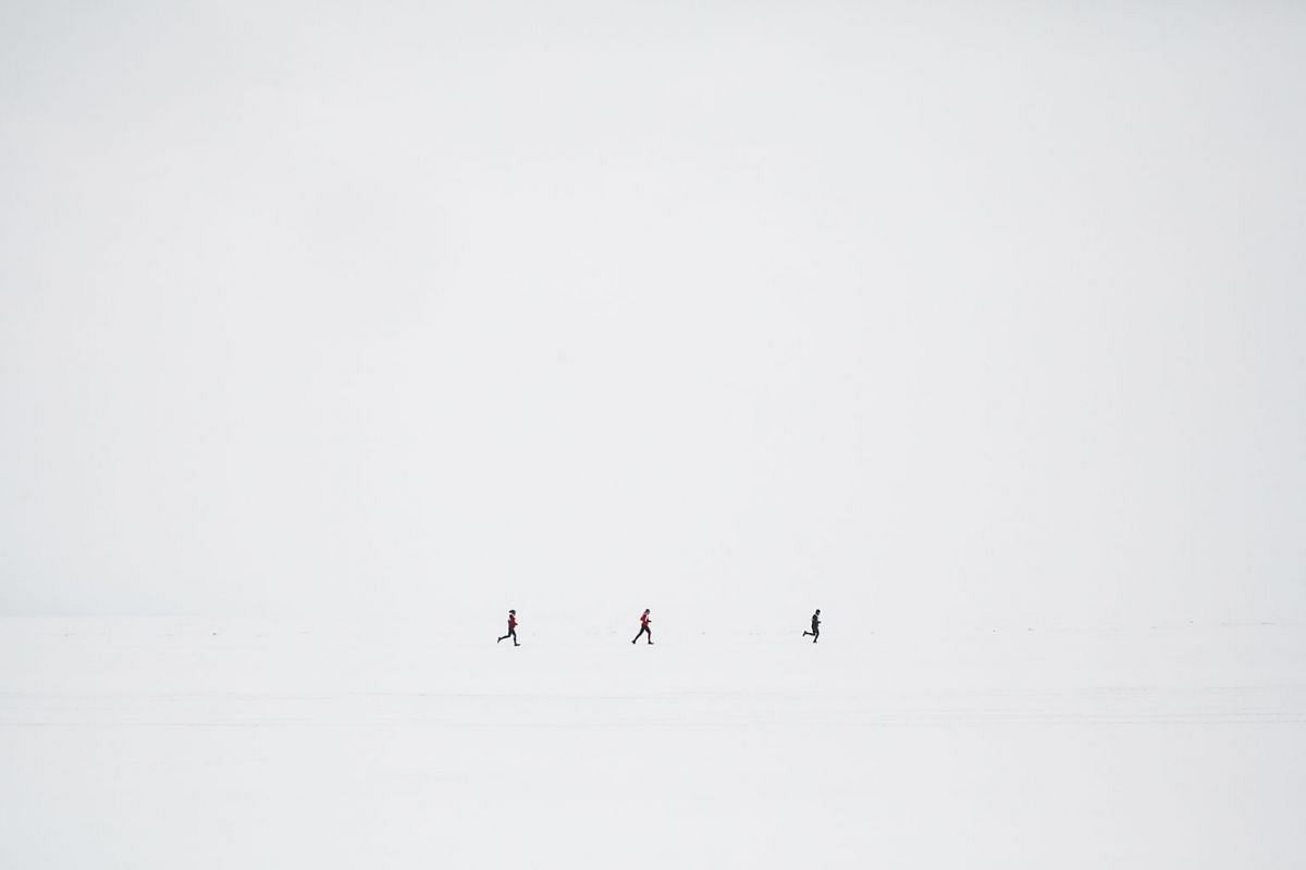 Baikal Ice Marathon participants run on the frozen surface of Lake Baikal, in Russia, March 2, 2019. It is one of the world's most grueling races: 26 miles over Siberia's Lake Baikal, amid cracking ice and shifting weather.