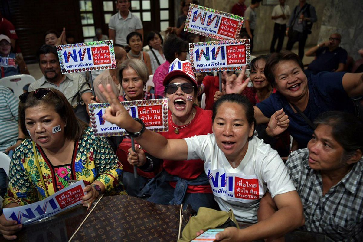 Supporters at the Pheu Thai party's headquarters in Bangkok react as the election results trickled in on March 24, 2019.