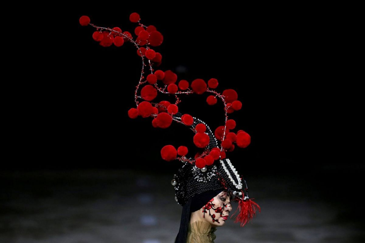 A model presents a creation by designer Hu Sheguang at China Fashion Week in Beijing, China, March 25, 2019.