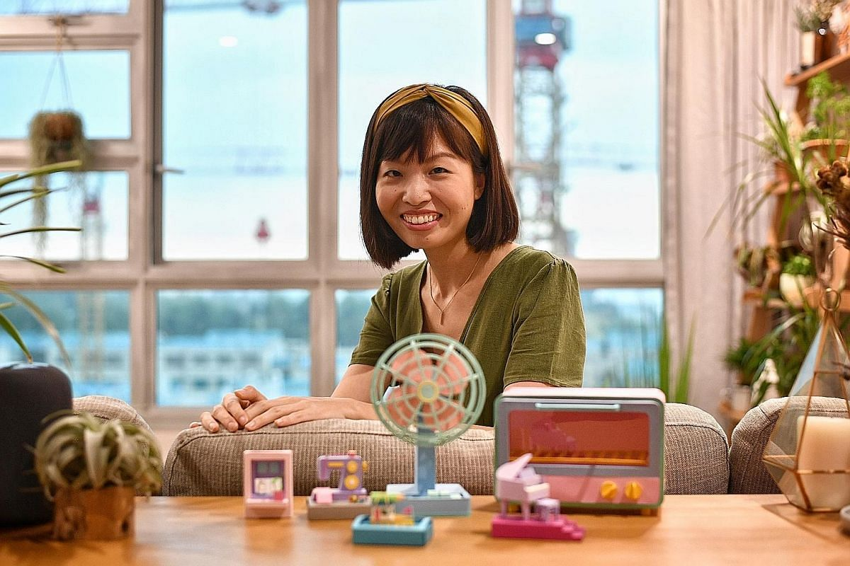 Besides miniature objects such as a sewing machine (top) and a train (left), the paper art of Cheryl Teo includes a mini-sculpture of the Palembang prince Sang Nila Utama (above), who established the kingdom of Singapura. Paper artist Cheryl Teo (abo