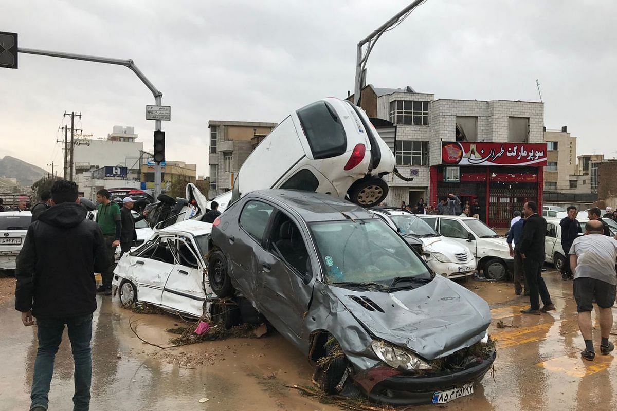 An image made available by Iran's Mehr News agency on March 25, 2019, shows cars pilling up in a street in the southern city of Shiraz. At least 12 people were killed and 45 injured in floods that swept across most Iranian provinces, the country's em