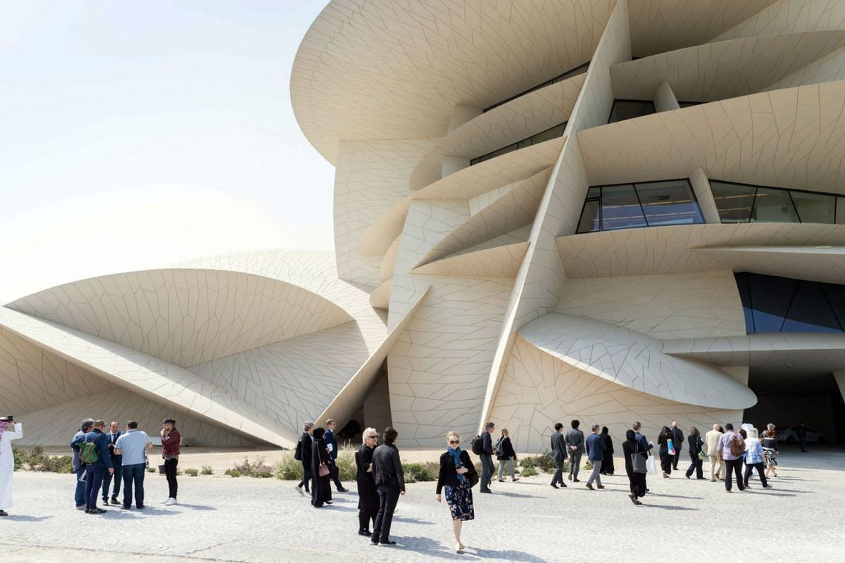 Visitors in front of the National Museum of Qatar building designed by Pritzker Prize-winning, French architect Jean Nouvel. Nouvel will be at the inauguration of the desert rose-shaped museum which opens on Mar 28, 2019. PHOTO: HANDOUT VIA AFP