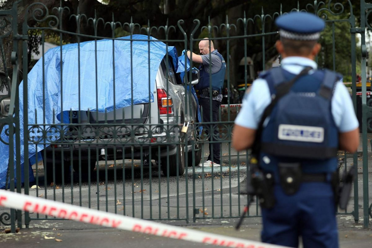 Police investigate a vehicle at the scene where a man died of stab wounds in Christchurch on March 27, 2019. Christchurch police launched an urgent investigation on March 27 to find out whether a man who died after an early morning stand-off with arm