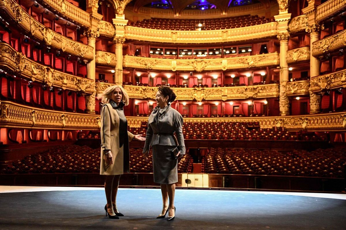 French president's wife Brigitte Macron and Chinese president's wife Peng Liyuan visit the Palais Garnier opera house in Paris on March 25, 2019, as part of a state visit to France. The Chinese president is on a three-day state visit to France. PHOTO