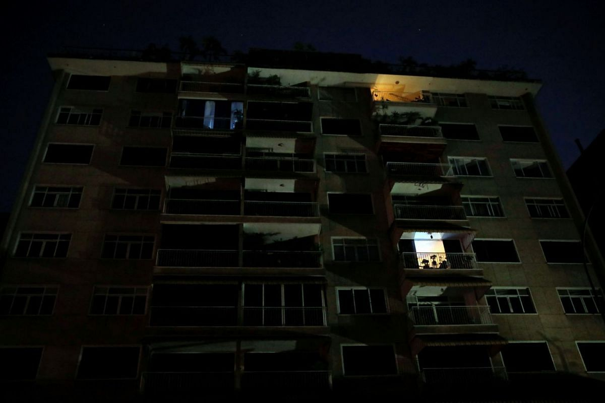 A view of an apartment block during a blackout in Caracas, Venezuela March 26, 2019. The Government of Nicolas Maduro has not been able to restore the supply of energy after two blackouts that hit Venezuela, and continue to keep a large part of the c