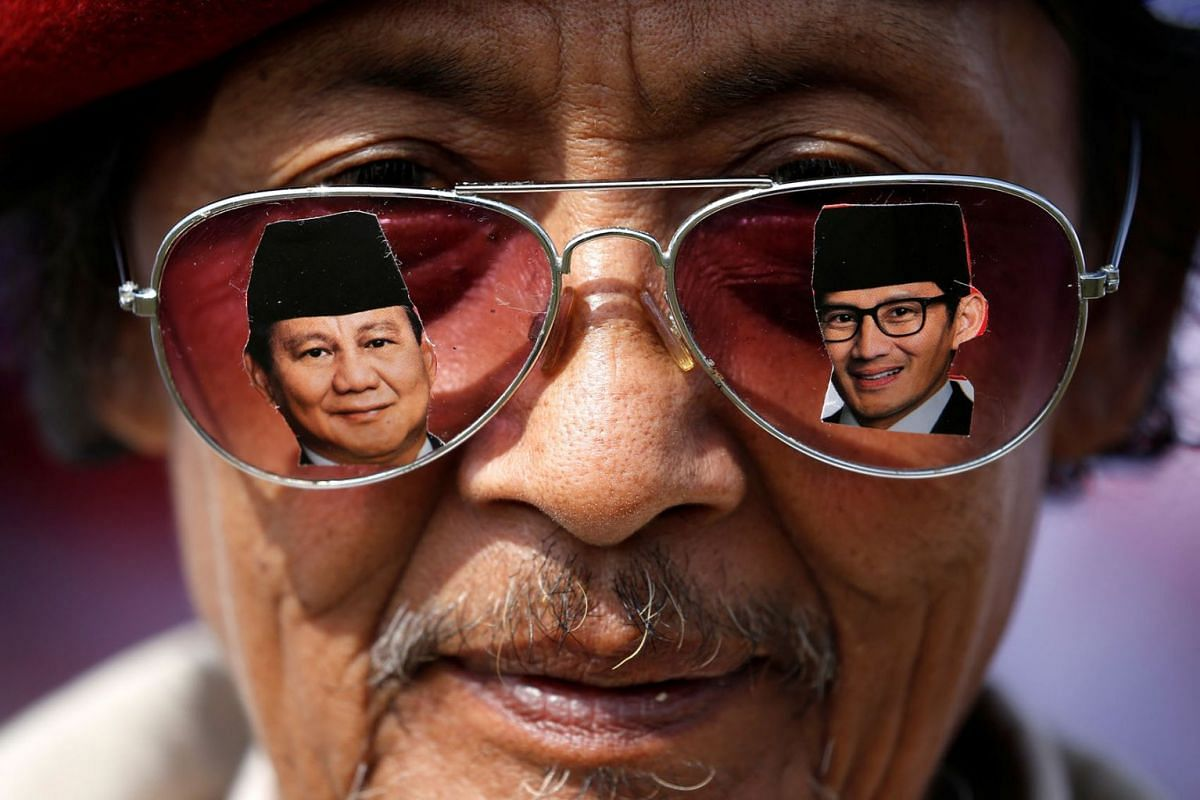 A supporter wears glasses as he attends a campaign rally of Indonesia's presidential candidate Prabowo Subianto for the upcoming general election. The photo was taken in Bandung, West Java province, Indonesia, March 28, 2019.