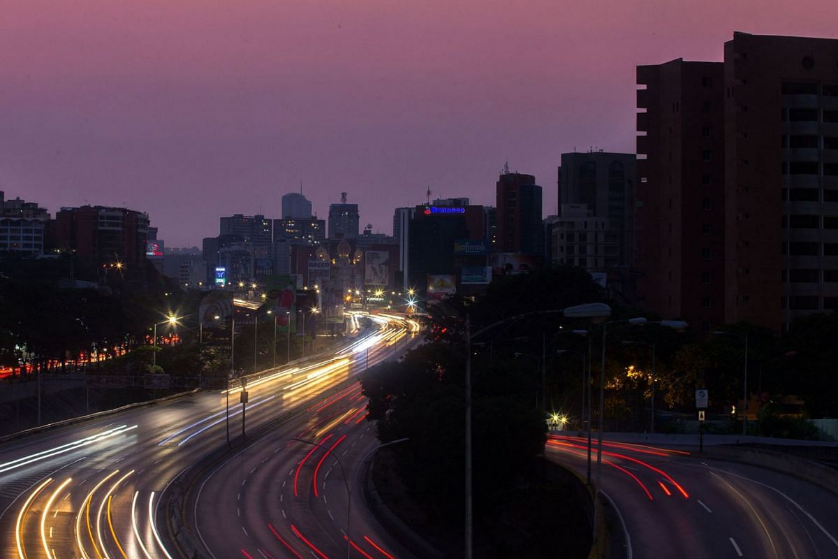 General view of Francisco Fajardo highway partially illuminated during a power outage in Caracas, Venezuela, on March 26, 2019.  Venezuela decreed a 24-hour holiday Tuesday to cope with a new near-nationwide blackout that the government alleged was c