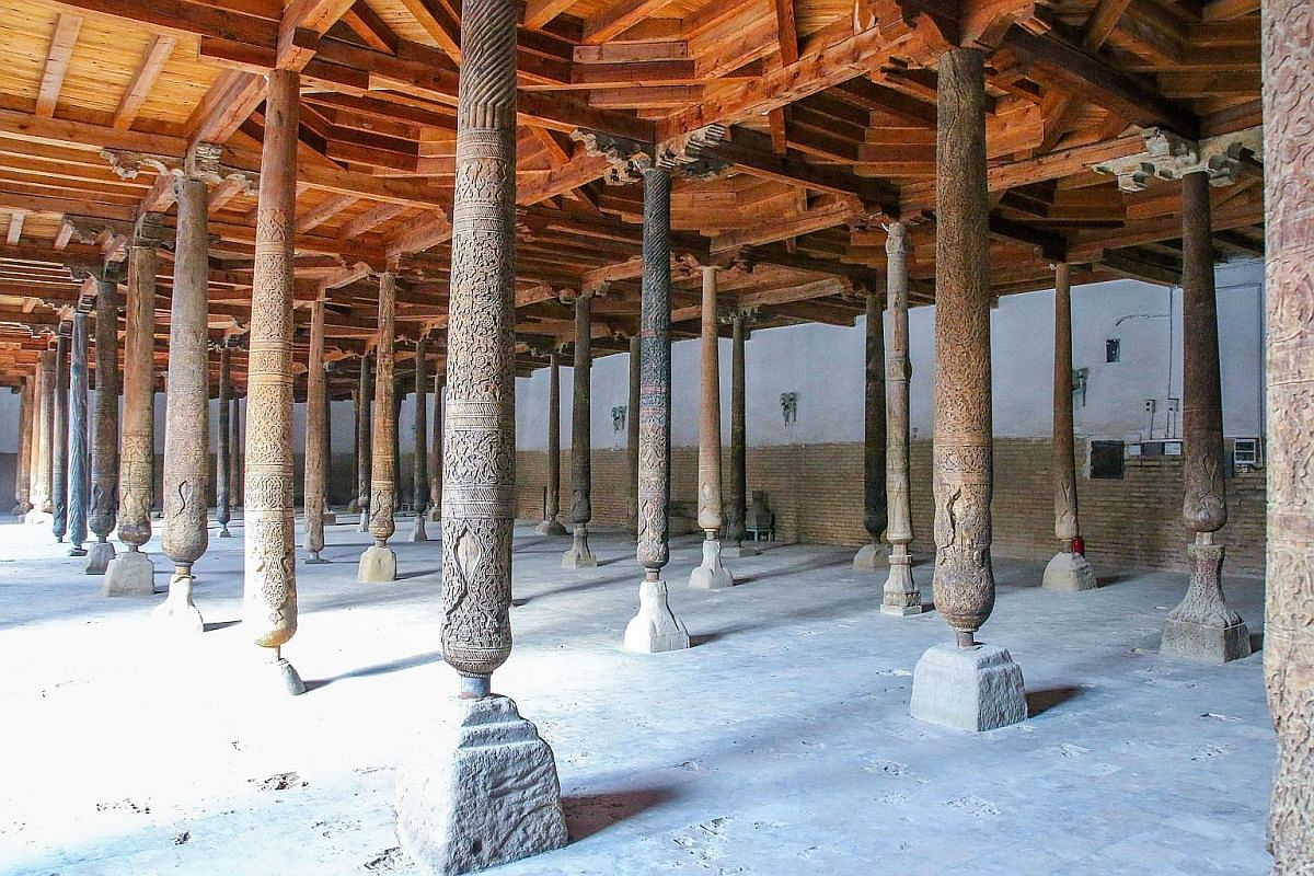 Intricately carved pillars line the hall of the Jumat Mosque in Ichan Qala.