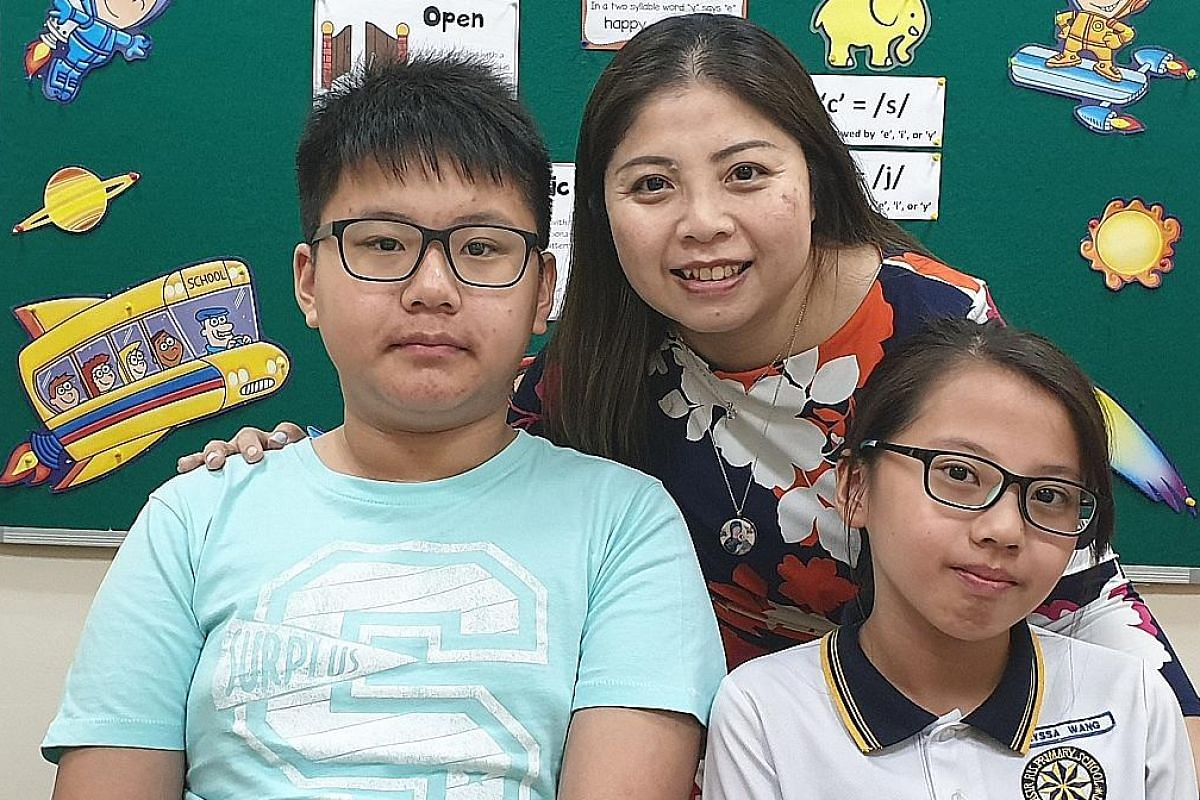 Ms Doreen Fong tells her two dyslexic children - Zachary and Alyssa Wang - that a good attitude is more important than good grades.