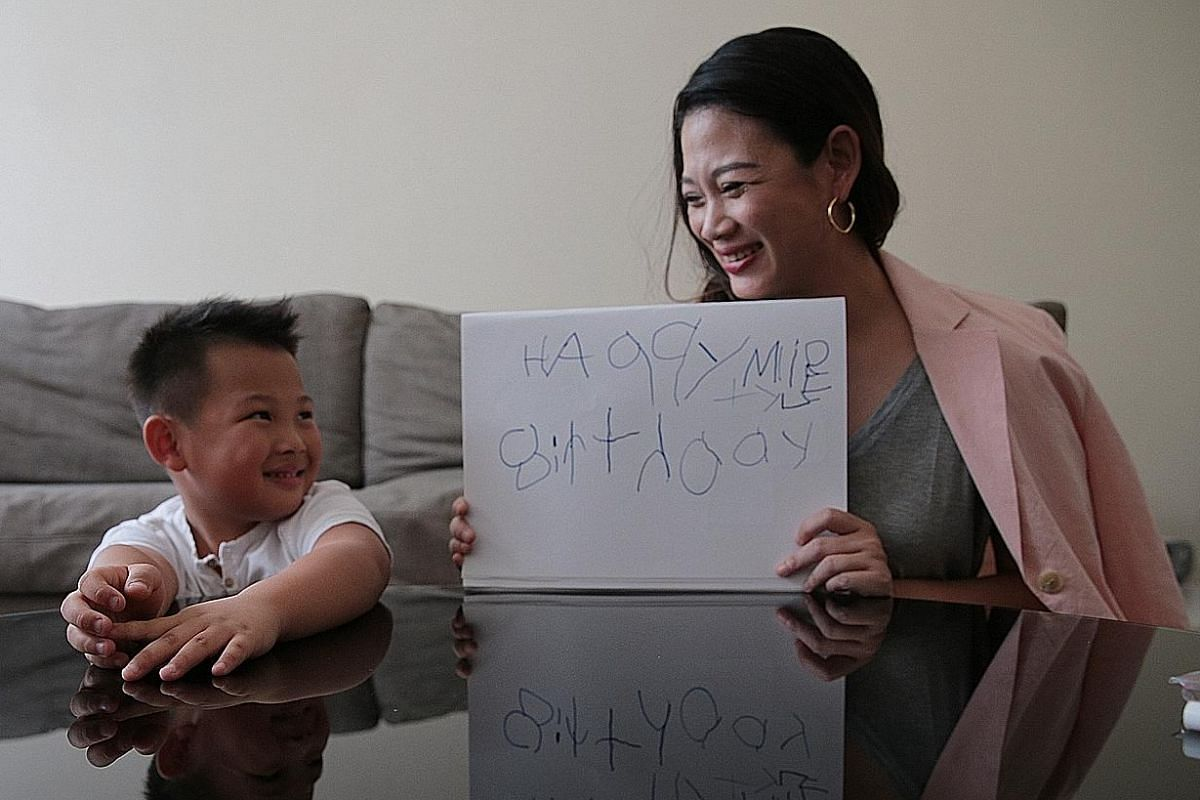 """Entrepreneur Tjin Lee and her six-year-old elder son, Tyler, who has dyslexia, who wrote the words """"Happy birthday"""" and his name."""