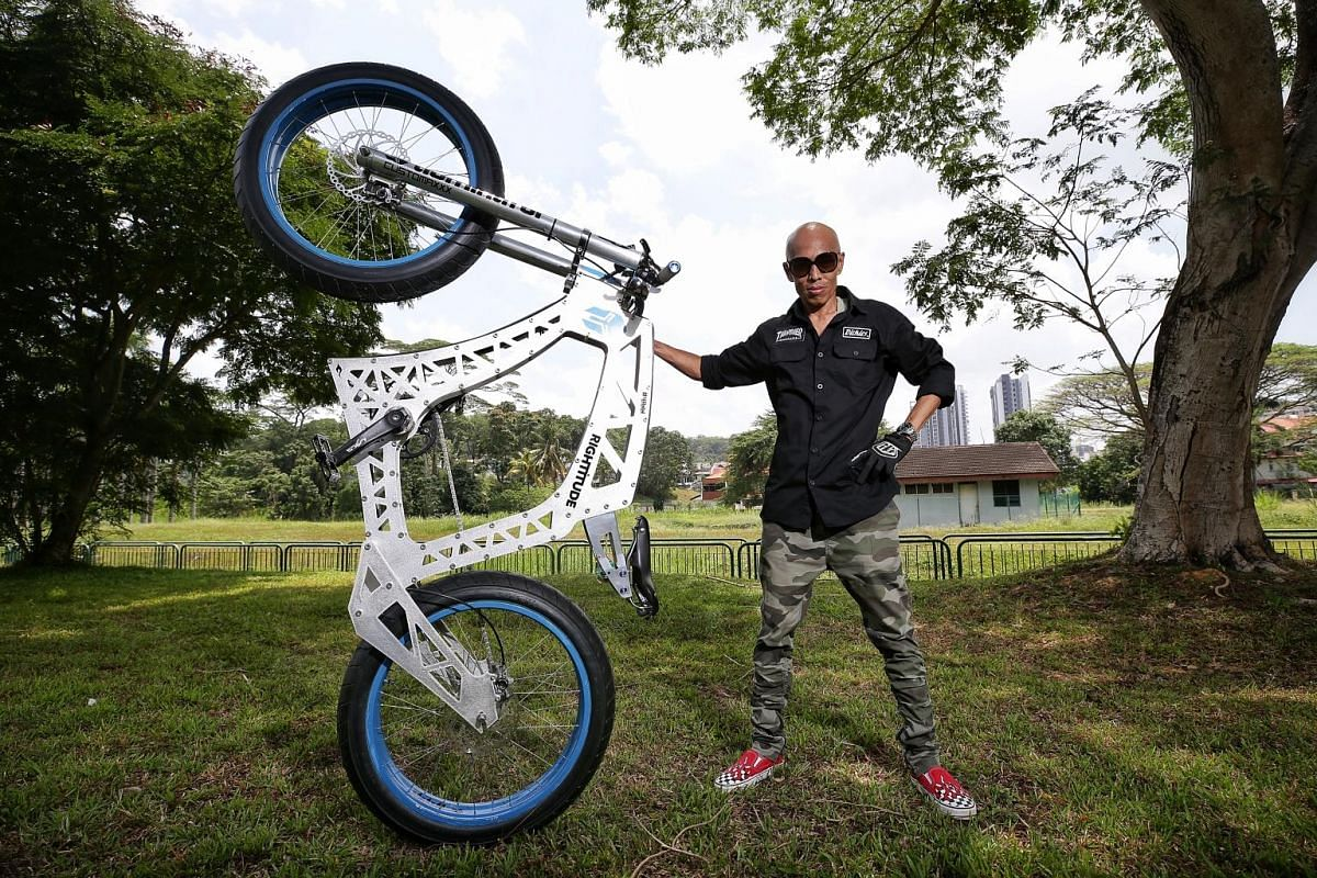 Lewis Foo (above) on his unusually long bicycle. Rosman Lamri's motorbike-looking dream bike (right) is just one of his eight customised bicycles.