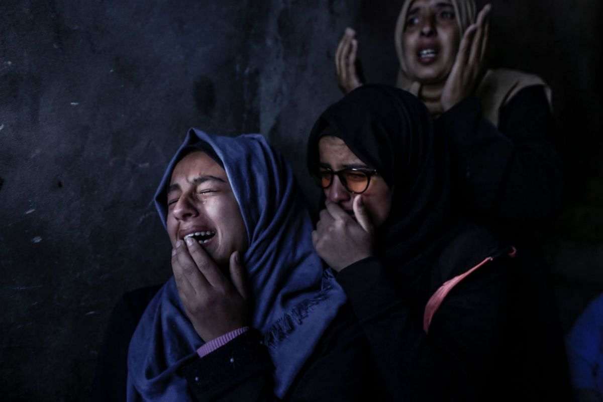 Relatives of Bilal al-Najjar, 17, mourn during his funeral in Khan Yunis in the southern Gaza Strip on March 31, 2019.  PHOTO: AFP