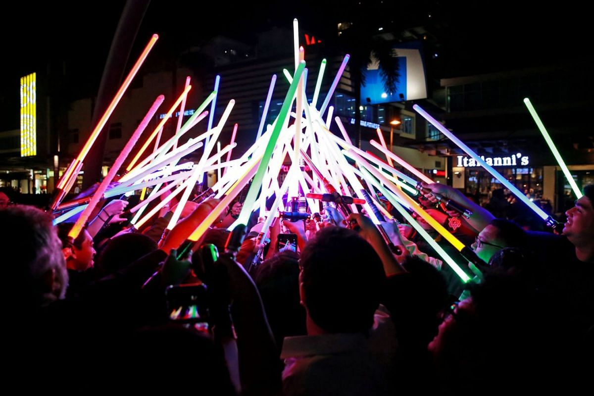 Star Wars enthusiasts huddle with their lightsabers after participating in Earth Hour at Taguig City, Philippines, March 30, 2019. PHOTO: REUTERS