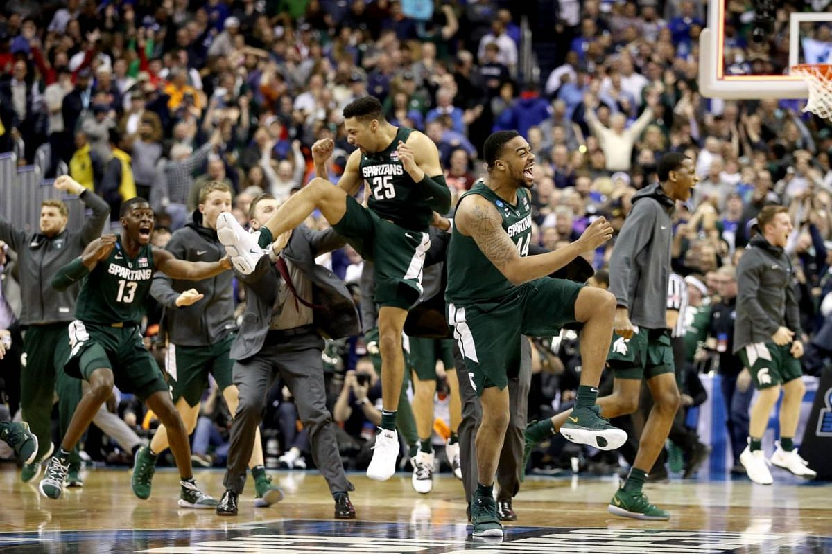 Nick Ward (No. 44) and Kenny Goins (No. 25) of the Michigan State Spartans celebrate their teams 68-67 win over the Duke Blue Devils in the East Regional game of the 2019 NCAA Men's Basketball Tournament at Capital One Arena on March 31, 2019, in Was