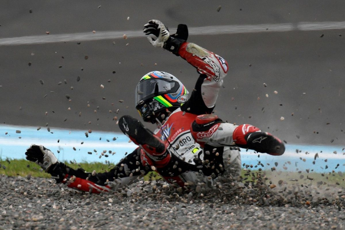 Italian motorcycle racer Stefano Manzi rolls after falling from his MV Agusta during the Argentina Grand Prix Moto3 race at the Termas de Rio Hondo circuit in Santiago del Estero, Argentina, on March 31, 2019. PHOTO: AFP