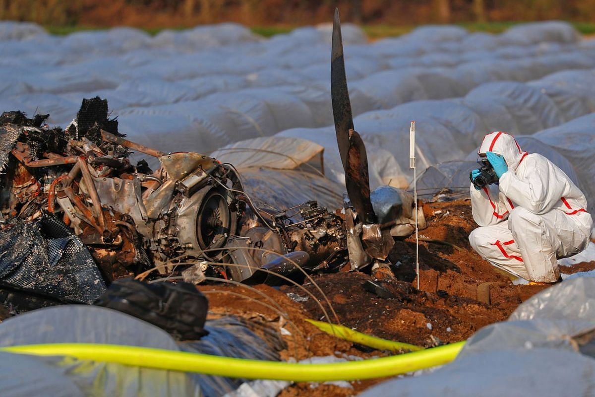 A forensic expert works next to the remains of a small plane that crashed near Erzhausen, Germany April 1, 2019. Natalia Fileva, chairwoman and co-owner of Russia's second largest airline S7, died when a private jet she was in crashed near Frankfurt