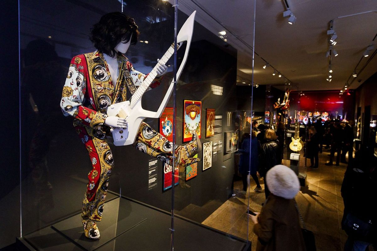 A guitar and outfit owned by Prince is seen during a preview of the new exhibit 'Play It Loud: Instruments of Rock & Roll' at the Metropolitan Museum of Art in New York, New York, USA, April 1, 2019. PHOTO: EPA-EFE
